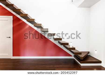 Horizontal view of modern and illuminated stairs - stock photo