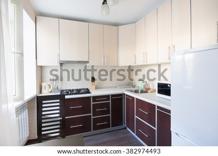 Horizontal view of modern furniture in kitchen - stock photo