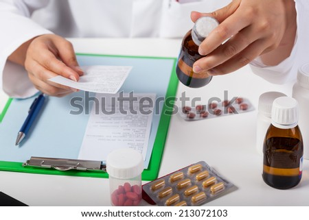 Horizontal view of pharmacist working in pharmacy - stock photo