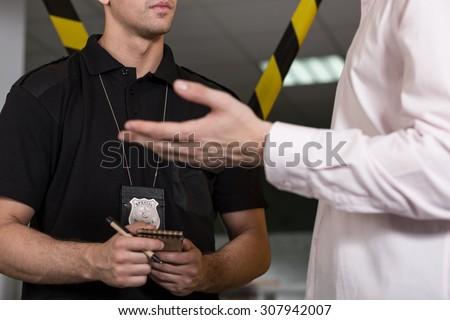 Horizontal view of policeman with police badge - stock photo
