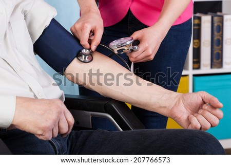 Horizontal view of pressure measurement in a hospice - stock photo