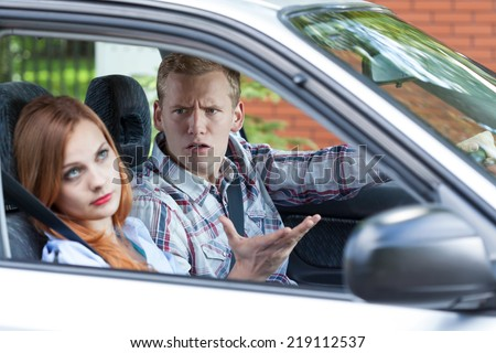Horizontal view of quarrel in a car - stock photo