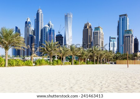 Horizontal view of skyscrapers and jumeirah beach in Dubai. UAE  - stock photo