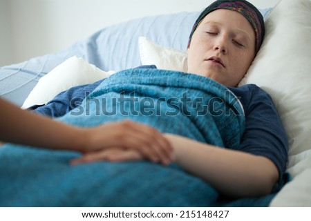 Horizontal view of sleeping woman with cancer - stock photo