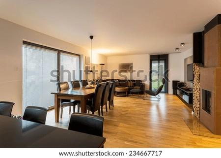 Horizontal view of spacious designer living room interior - stock photo