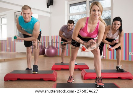 Horizontal view of training on the step - stock photo