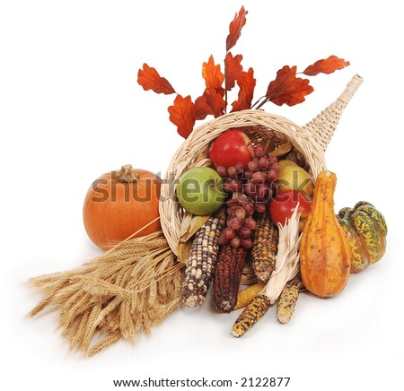 horn of plenty with autumn harvest of leaves, wheat pumpkin, squash, corn, apples, pear and grapes - stock photo