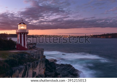Hornby lighthouse, also known as South Head Lower Light building on a cliff at the entrance to Port Jackson and Sydney Harbour. Located in Watsons Bay. During sunset. Long exposure - stock photo