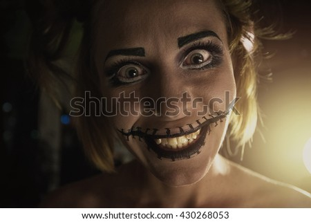 Horrible girl with scary mouth and eyes - stock photo