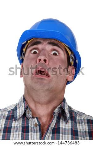 Horrified manual worker - stock photo