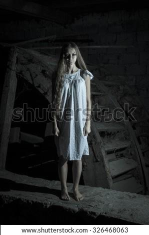 Horror girl in white dress - stock photo