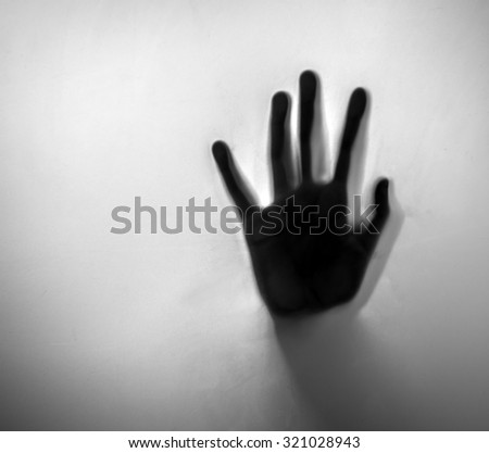 Horror hand. Diffused silhouette - stock photo