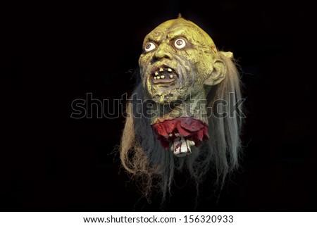 Horror head on black background - stock photo
