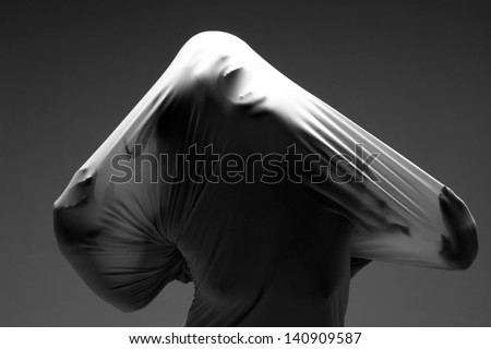 Horror Image of a Woman Trapped in Fabric - stock photo