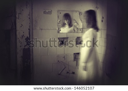 Horror movie scene with a creepy face in the mirror - stock photo