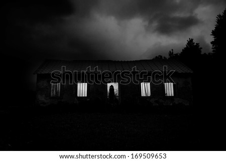 Horror Scene - Creepy abandoned house in the forest - stock photo