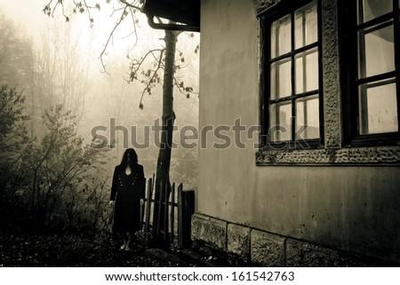 Horror scene of a female ghost - stock photo