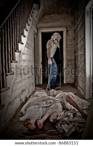 Horror scene of a hooded man dragging two women by a chain - stock photo