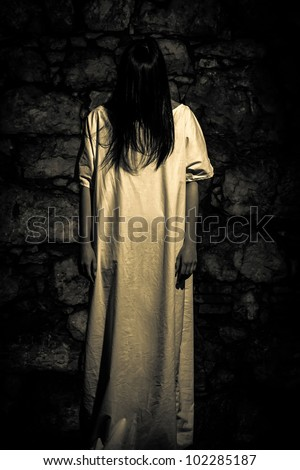 Horror Scene of a Long Black Hair Scary Woman - stock photo