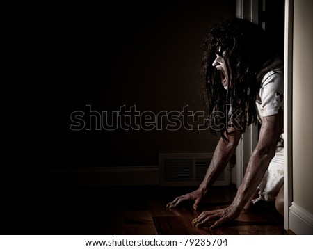 Horror Scene of a Possessed Woman - stock photo