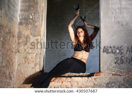 Horror Scene of a Scary Female Ghost at the Window. Capricorn or Goat woman. Halloween concept - stock photo