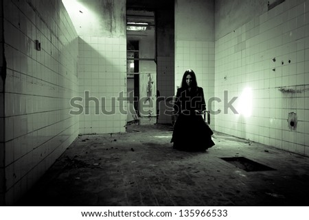Horror scene of a scary woman. Apparitions of the ghost. - stock photo