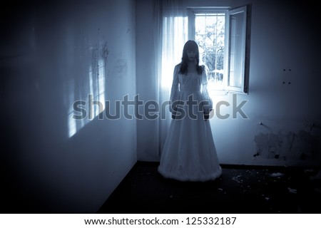 Horror Scene of a Scary Woman's Ghost - stock photo