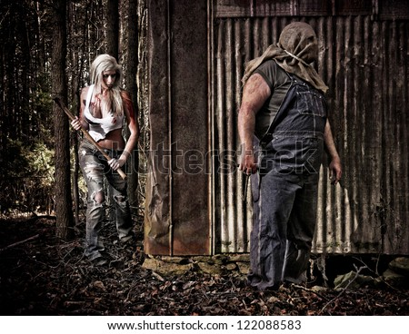 Horror scene of a woman hiding and getting revenge against a hooded man with a hook. - stock photo