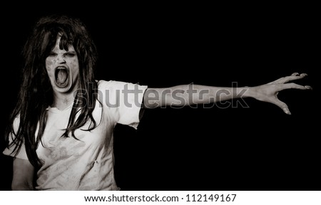 Horror Scene of a Woman Possessed with long arm and fingers space for text - stock photo