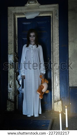 Horror Scene of woman which holding bear - stock photo