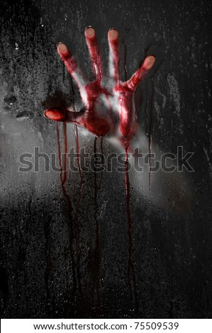 Horror Scene with Bloody Hand against Wet Shower Glass - stock photo