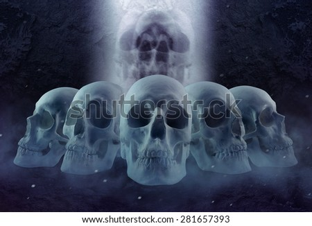 Horror skulls row and mist. Ghost spooky skulls composition lying in a row with cold foggy atmosphere. - stock photo