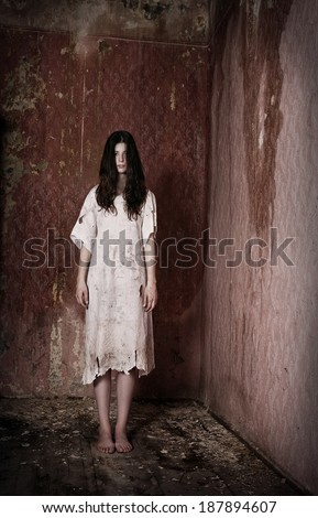Horror style scene - alone girl in creepy house - stock photo
