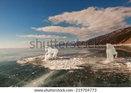Horse, a sculpture from ice on the frozen lake Baikal - stock photo