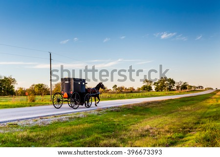 Horse and Buggy on Highway in Oklahoma Amish Country - stock photo