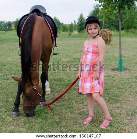 Horse and cute jockey - stock photo