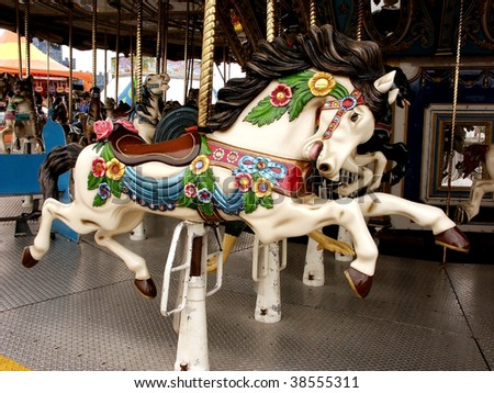 Horse carousel - stock photo