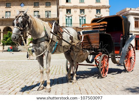 Horse carriage at San Francisco square in Old Havana - stock photo