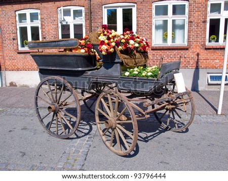 Horse carriage decorated with many colorful flowers - stock photo