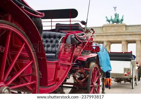 Horse cart near the Brandenburg Gate in Berlin, Germany - stock photo