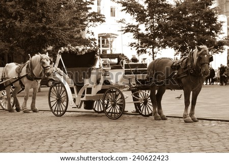 Horse-drawn caleche buggies in Montreal, Canada - stock photo