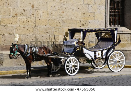 Horse drawn carriage waiting for tourists in historic Guadalajara, Jalisco, Mexico - stock photo