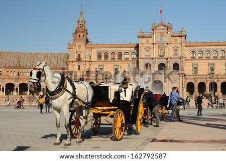 horse-driven barouche at Plaza de Espana in Seville - stock photo