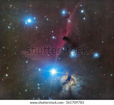 Horse head and Flaming nebula long-exposure photo - stock photo