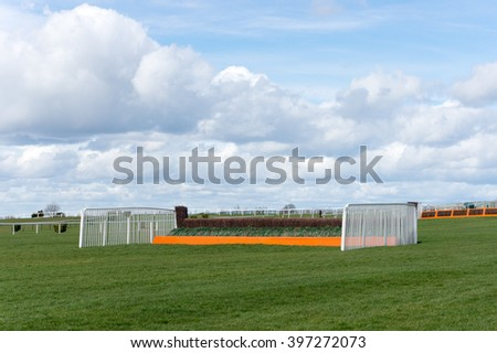 Horse jump fence at Cheltenham Racecourse.  - stock photo