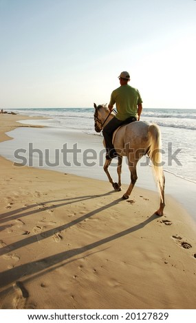horse riding at the beach - stock photo