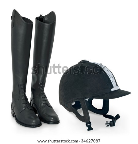 horse riding helmet and boots - stock photo