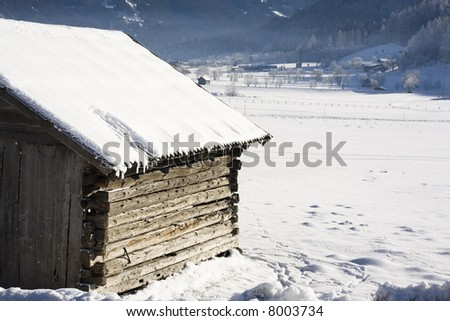 Horse stable covered with snow - stock photo