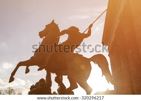 Horse statue at the door of the Altes Museum (Old Museum) in Berlin at sunset, Germany, toned image. - stock photo