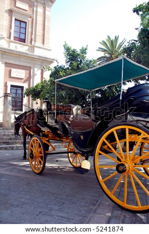 horses and carriages for sightseeing in Seville, Spain - stock photo